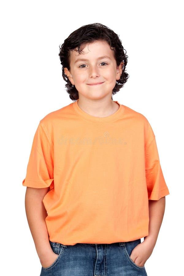 Grappig kind met oranje t-shirt stock afbeelding