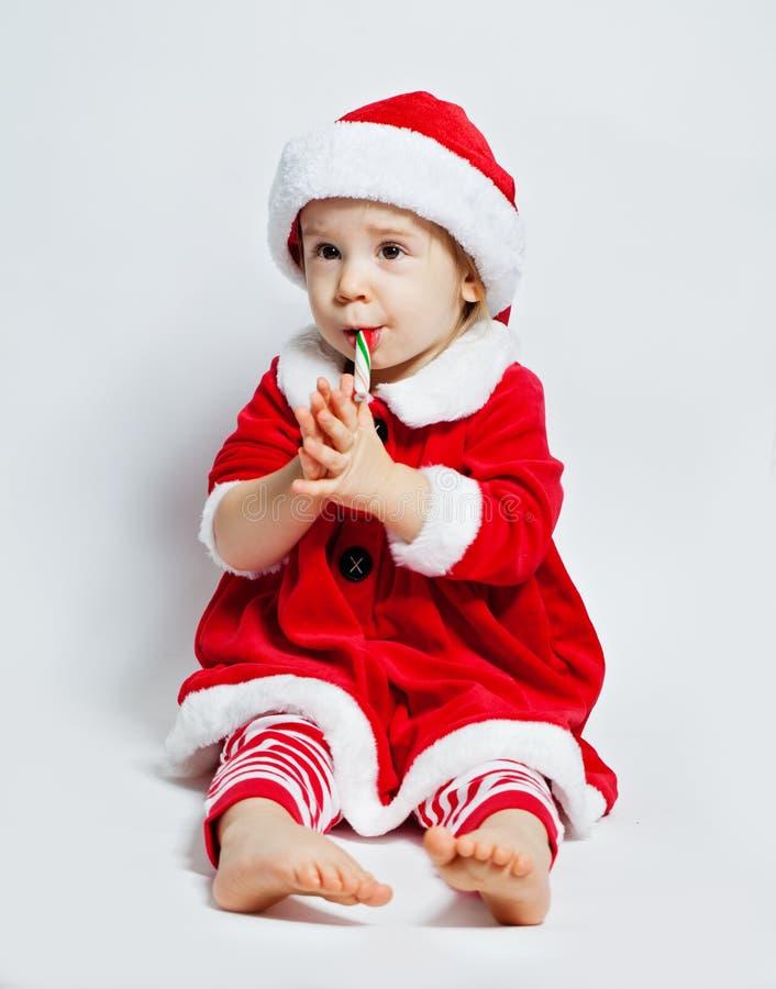 Grappig kind in santahoed, Kerstmisportret royalty-vrije stock foto