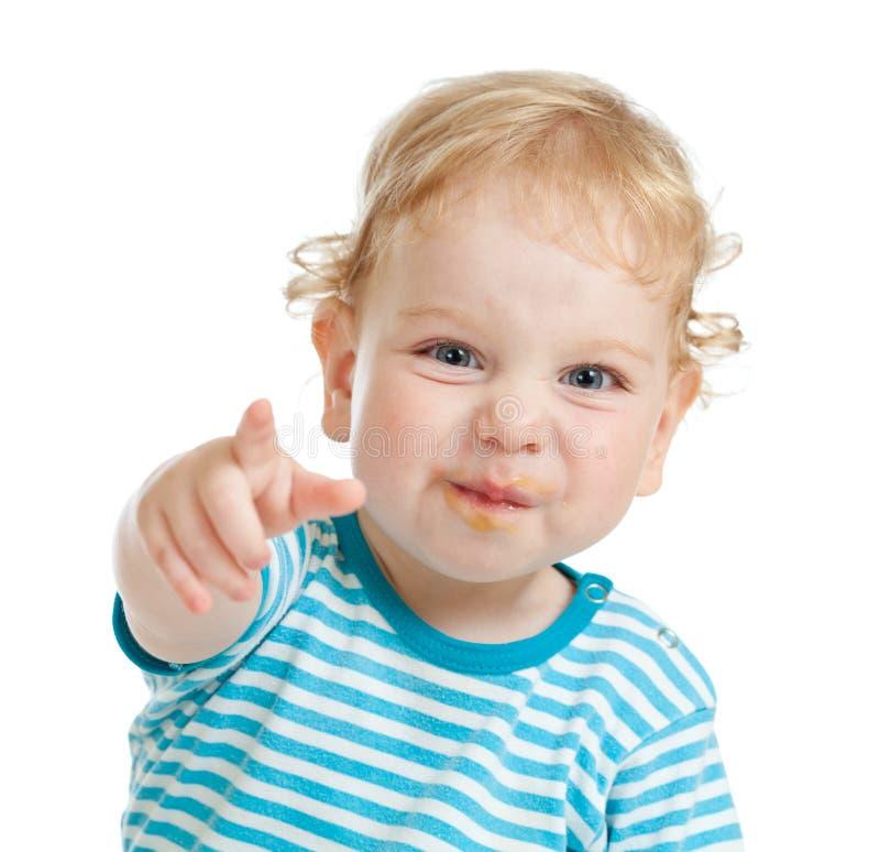 Grappig krullend kind met vuile lippen stock afbeeldingen