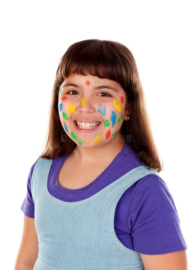 Grappig meisje met gezichtshoogtepunt van verf stock fotografie
