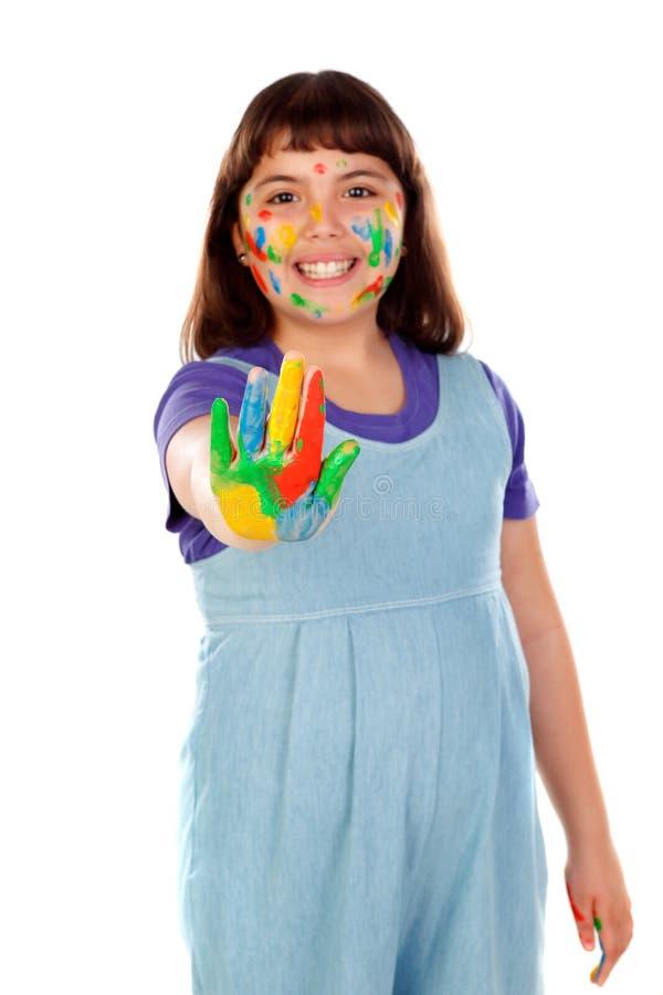 Grappig meisje met haar handen vuil van verf royalty-vrije stock fotografie