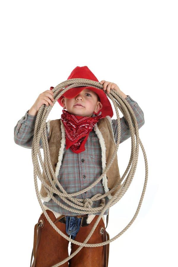 Grappig stel van een jonge cowboy die een kabel houden royalty-vrije stock fotografie
