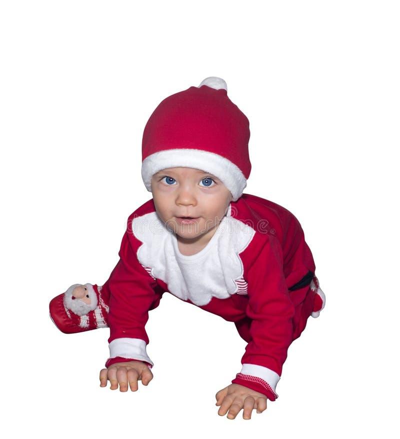 Grappige baby wirh blauwe ogen in Santa Claus-geïsoleerde kleren stock foto