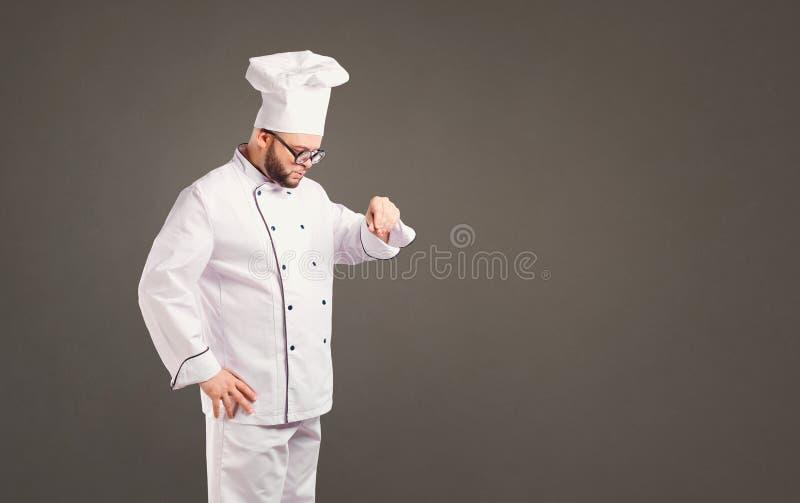 Grappige chef-kok met baardkok stock foto's
