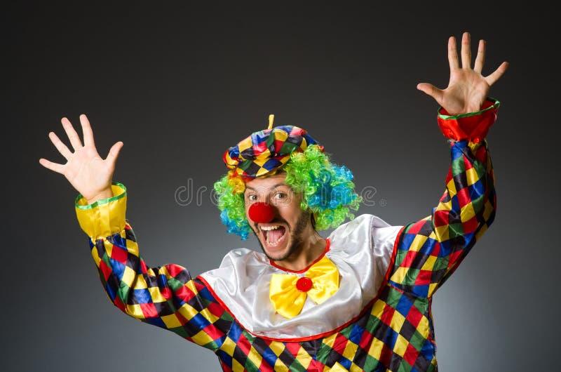 Grappige clown in kleurrijk stock afbeelding