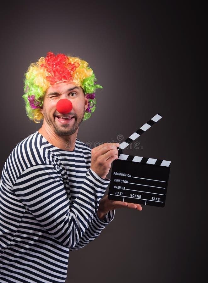 Grappige clown met clipper doos stock fotografie