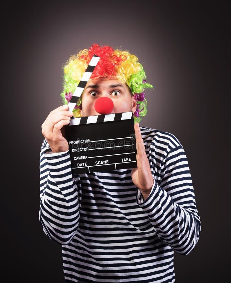 Grappige clown met clipper doos royalty-vrije stock afbeeldingen