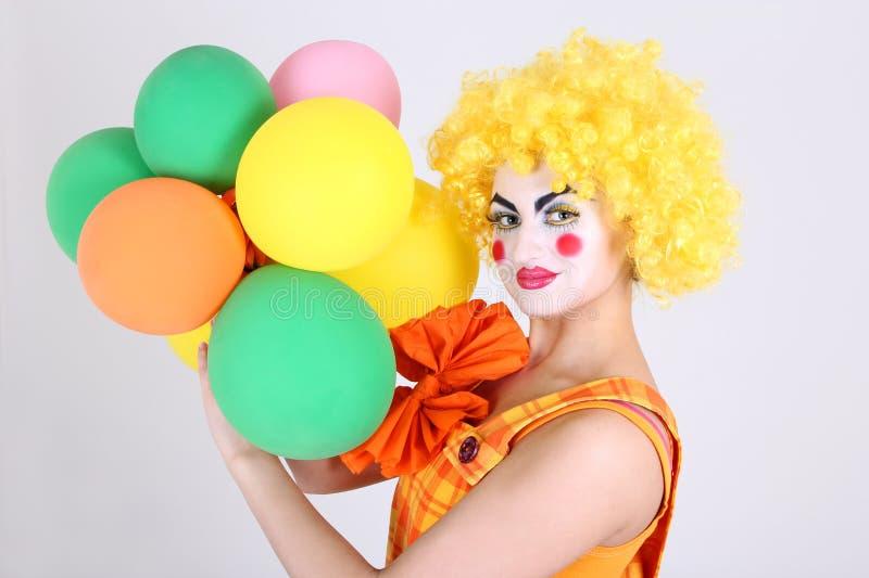 Grappige clown met kleurrijke ballons royalty-vrije stock afbeelding