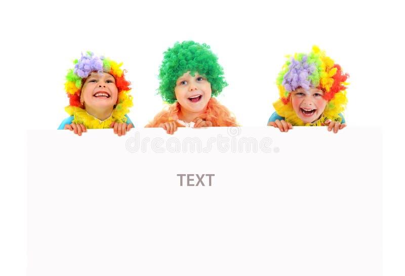 Grappige clowns bij de partij met witte spatie stock afbeeldingen