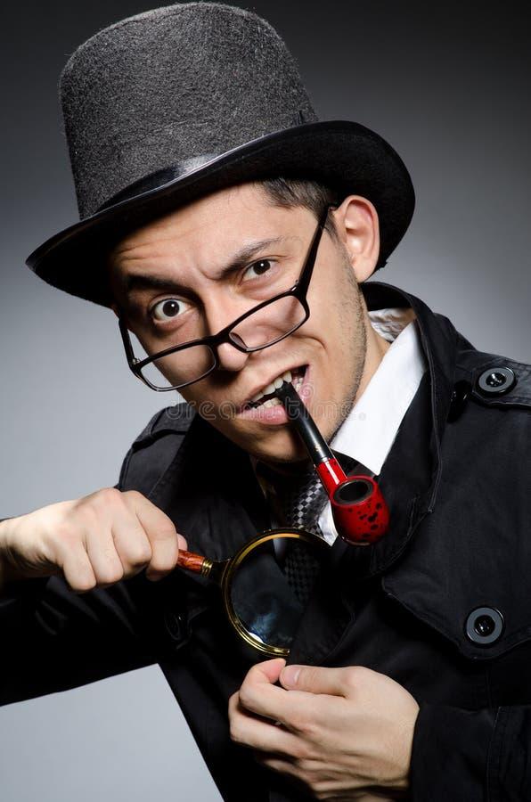Grappige detective met pijp stock afbeelding