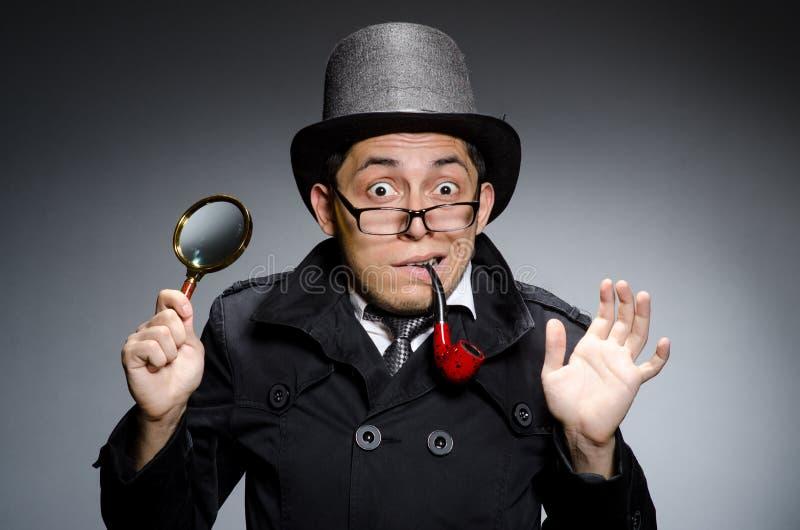 Grappige detective met pijp royalty-vrije stock fotografie