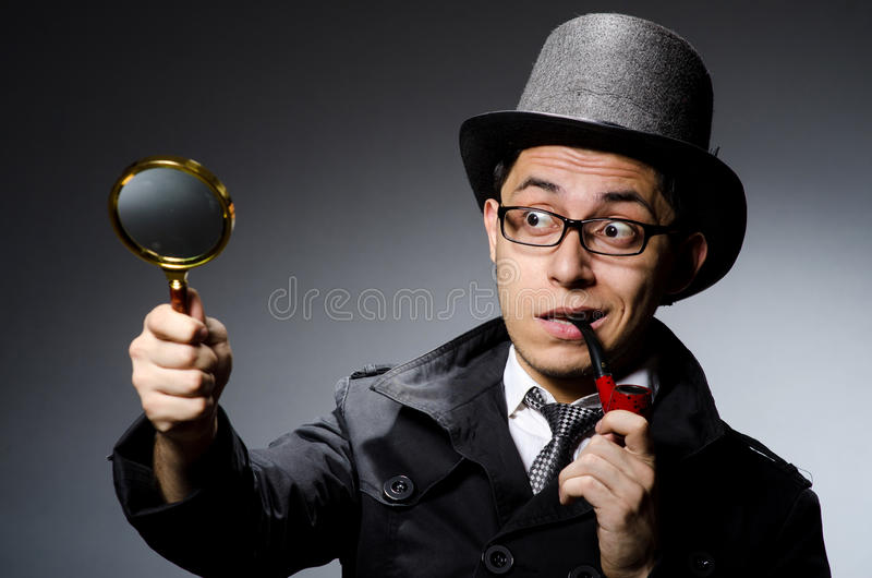 Grappige detective met pijp stock foto's