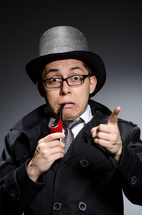 Grappige detective met pijp royalty-vrije stock afbeeldingen