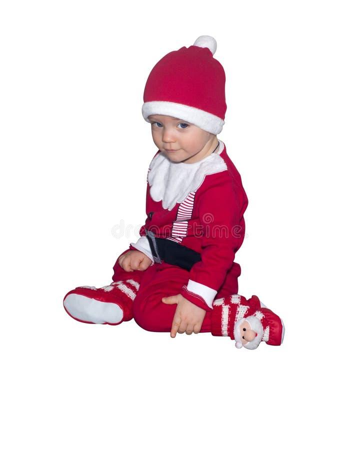 Grappige die baby in Santa Claus-kleren op witte achtergrond wordt geïsoleerd stock foto