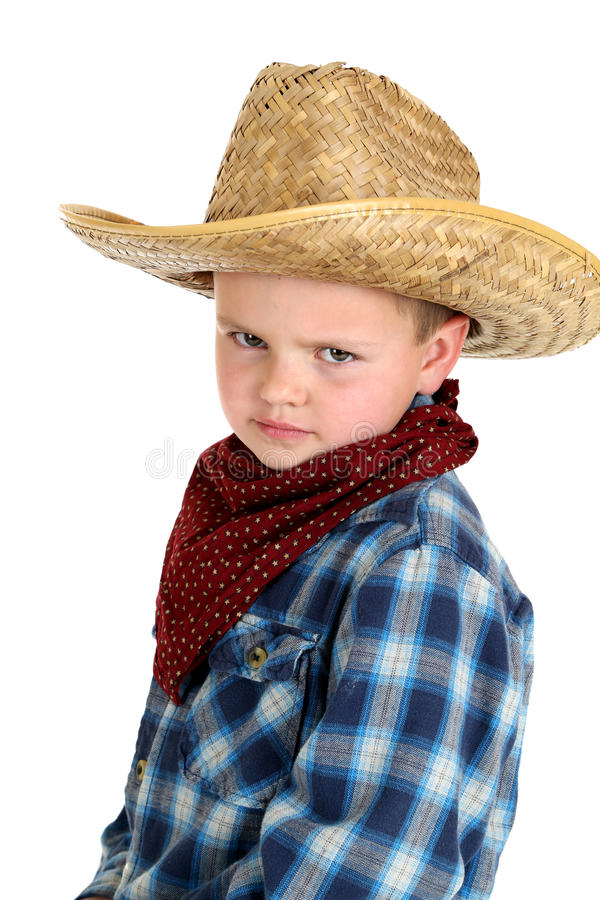 Grappige glraing jonge cowboy wearning hoed en bandana stock afbeelding