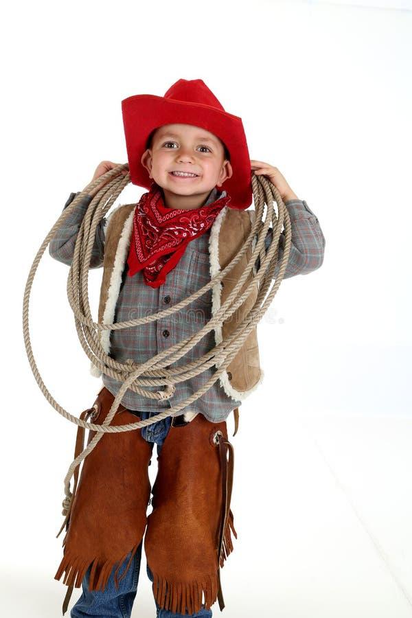 Grappige jonge cowboy die met slappe oren houdend een kabel glimlachen stock afbeelding