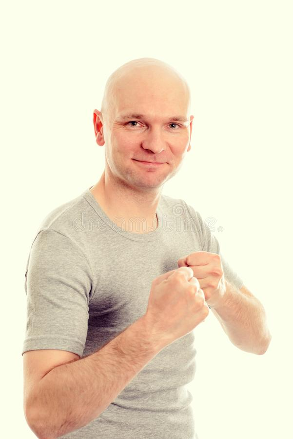 Grappige jonge mens met vuisthanden stock foto