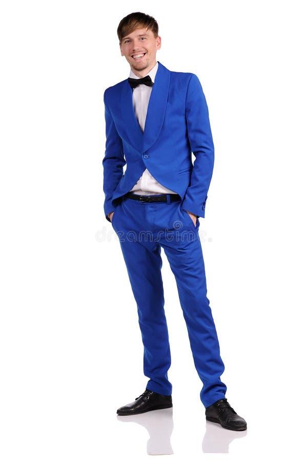 Grappige mens in blauwe reeks op witte achtergrond stock fotografie