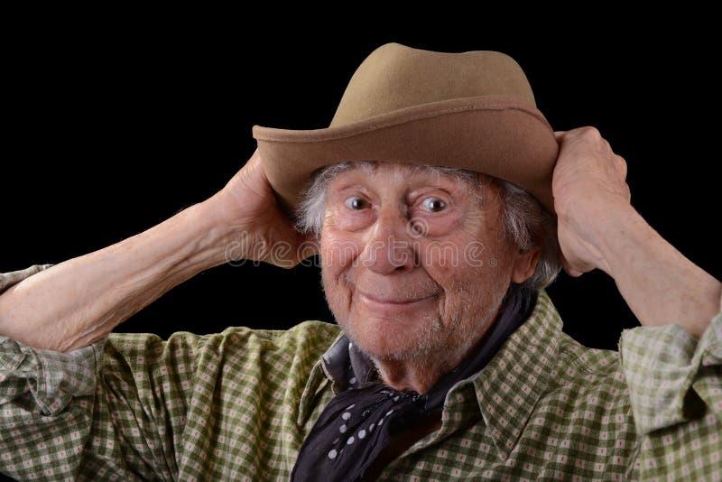 Grappige oude mens in een hoed stock foto