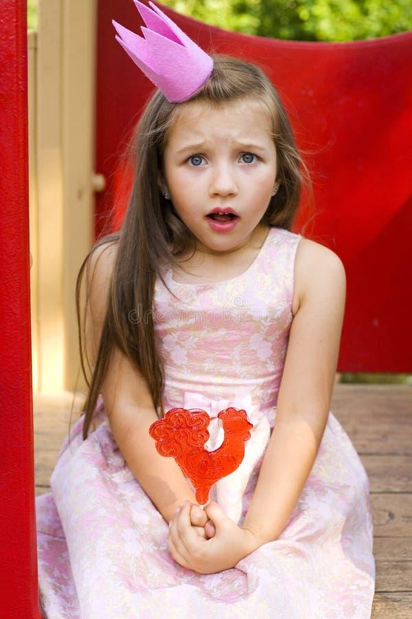 Grappige prinses en een lolly royalty-vrije stock foto's
