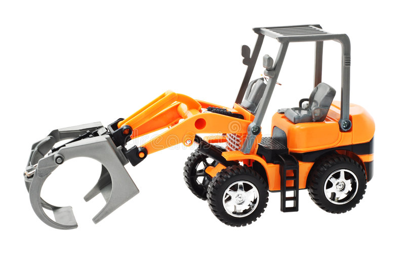 Grapple loader tractor. Toy model of grapple loader tractor on white background royalty free stock photo