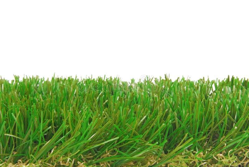 Gras künstlicher astro Rasen lokalisierte Grenze stockfotografie