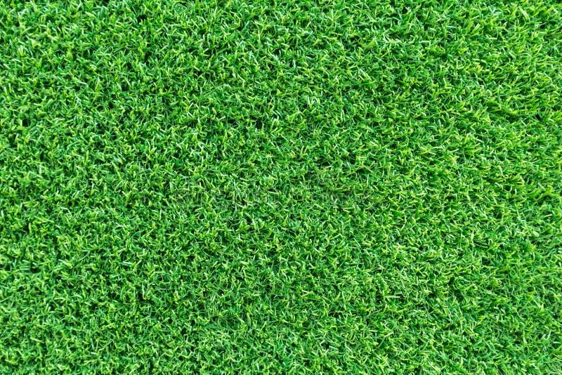 Grasbeschaffenheitshintergrund für Golfplatz-, Fußballplatz- oder Sportkonzeptentwurf Künstliches grünes Gras lizenzfreie stockbilder