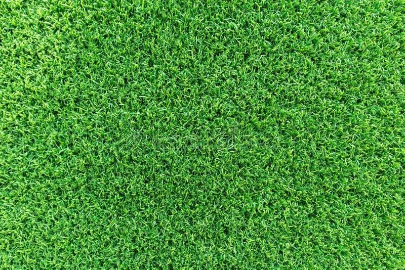 Grasbeschaffenheitshintergrund für Golfplatz-, Fußballplatz- oder Sportkonzeptentwurf Künstliches grünes Gras stockbild