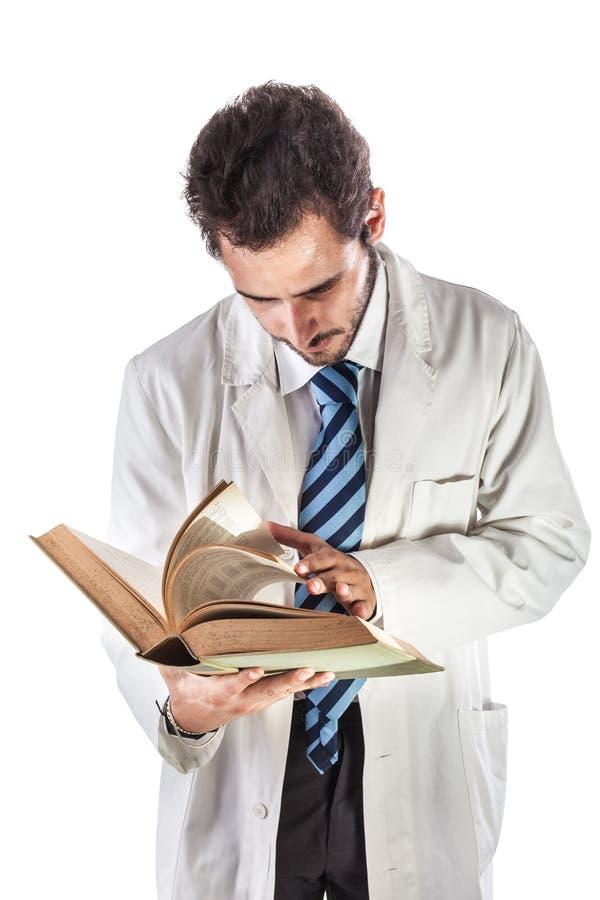 Grasender Doktor stockbild