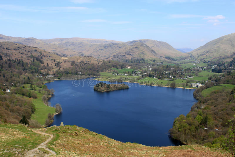 Grasmere from Loughrigg Fell, English Lake District. View looking North West from the slopes of Loughrigg Fell in the English Lake District. The lake is Grasmere royalty free stock photography