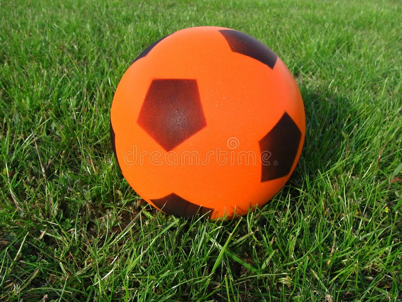 Grass and ball stock photography