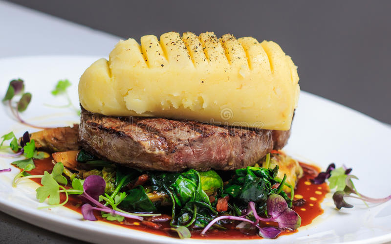 Grass Fed scotch fillet with mustard mash, brussels sprouts stock photos