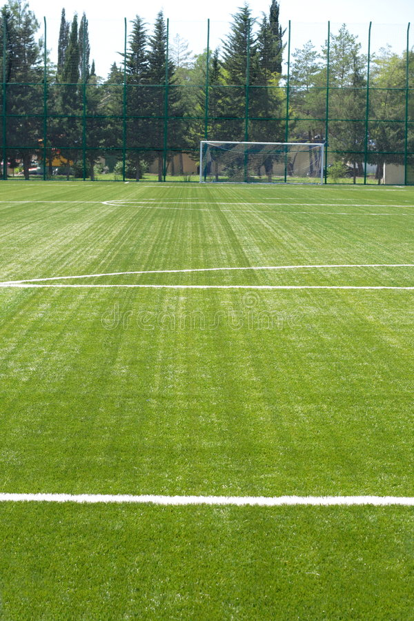 Grass field for soccer. European football field for training royalty free stock photography