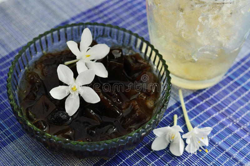Grass jelly. Dessert cups of Grass jelly with Ice stock photos