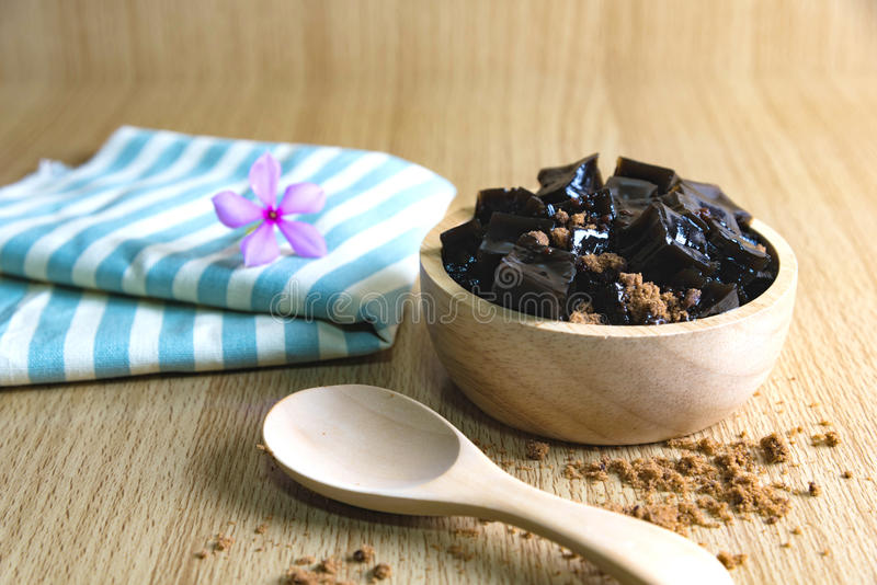 Grass Jelly on wooden table. Grass jelly Mesona chinensisIt`s Southeast Asia Dessert made from made by boiling the aged and slightly oxidized stalks with sugar royalty free stock images