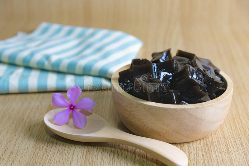 Grass Jelly on wooden table. Grass jelly Mesona chinensisIt`s Southeast Asia Dessert made from made by boiling the aged and slightly oxidized stalks with sugar royalty free stock photos