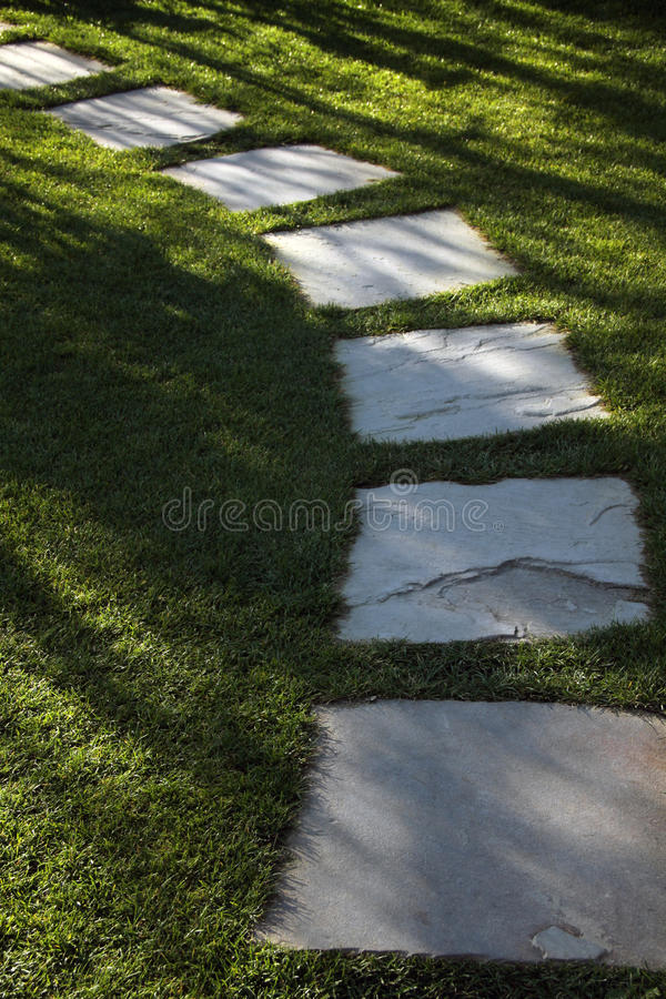 Grass lawn and stone garden path