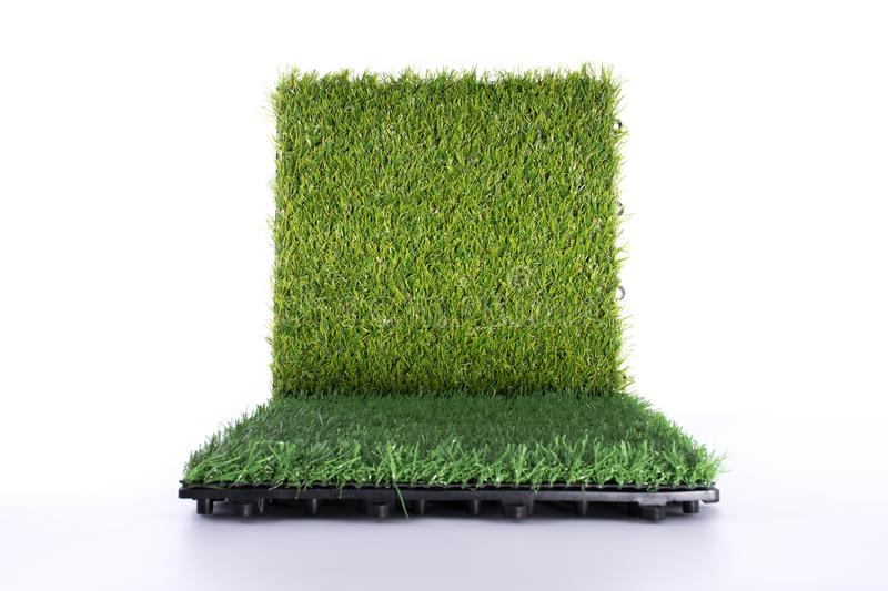 Grass mat on white background. Artificial turf tile background. Object and background concept. Court, fake, interior, field, golf, green, isolated, backyard stock photography