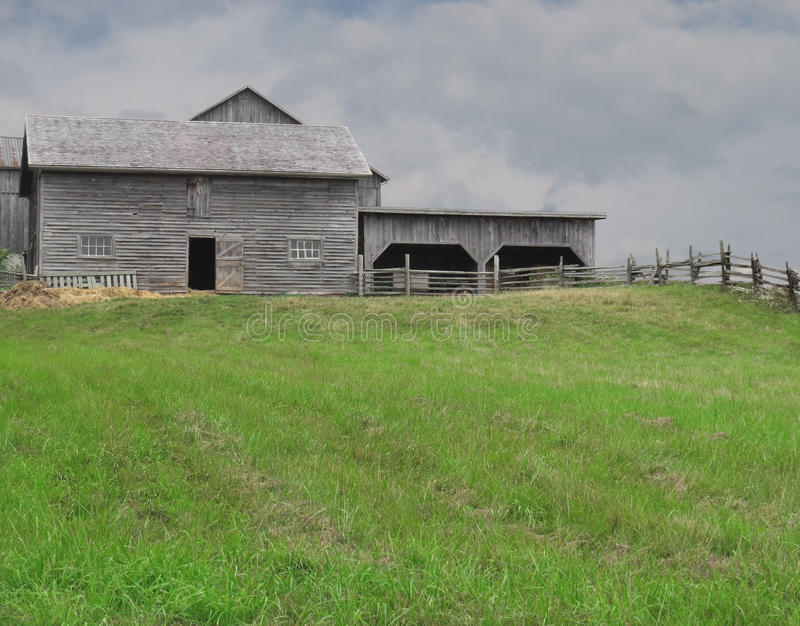 Grass pasture with farm buildings stock photo