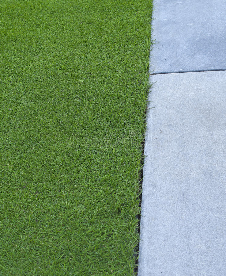 Grass and paving royalty free stock photos