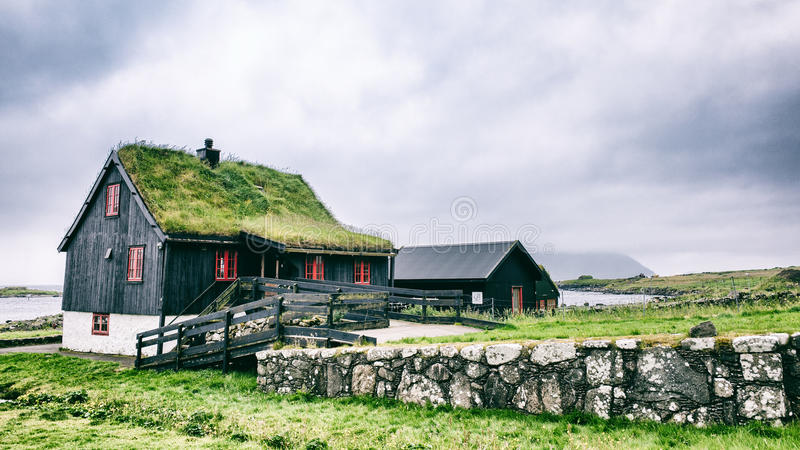 Grass roof house stock photos