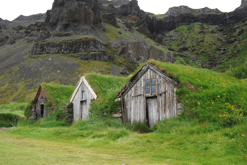 Grass roofed houses in Iceland used as shelter for travellers. To take refuge in bad weather when on their journey stock photo