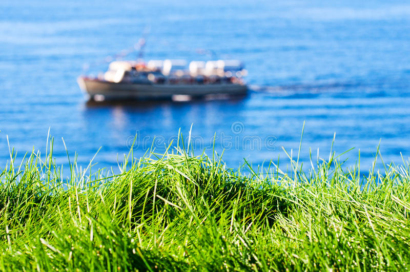 Download Grass With Seas And Boat On Background Stock Photo - Image: 21890962