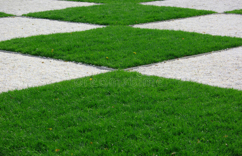 Grass square. Detail: green space in a park royalty free stock photos