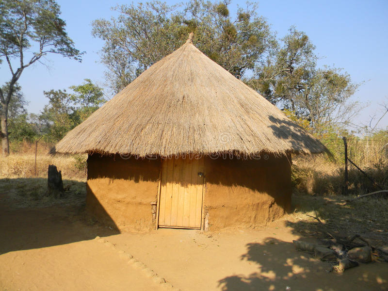 Grass thatched African pole and dagga hut. royalty free stock images