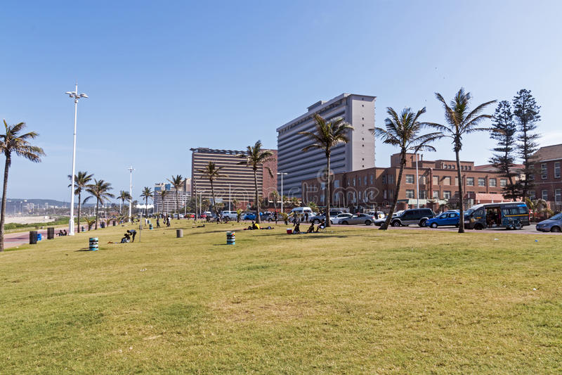 Grass Verge Against Goldem Mile City Beach Front Skyline. DURBAN, SOUTH AFRICA - DECEMBER 19, 2016: Early morning empty grass verge against Goldem Mile city royalty free stock photos