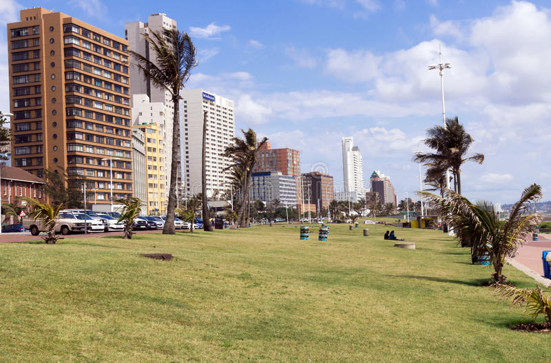 Grass Verge Against Goldem Mile City Beach Front Skyline. DURBAN, SOUTH AFRICA - DECEMBER 12, 2016: Early morning empty grass verge against Goldem Mile city royalty free stock photos