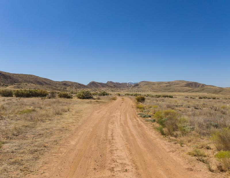Grassland Dirt Road in Wilderness stock images