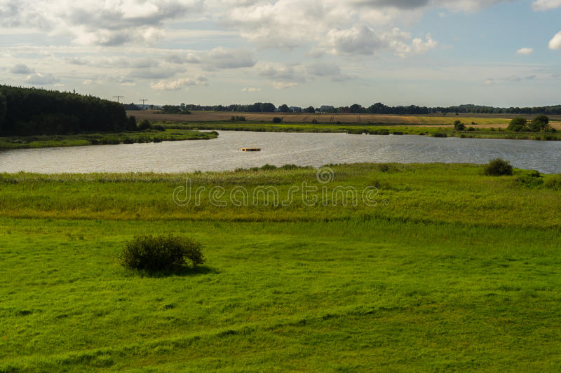 Grassland in front of Eixen lake royalty free stock photography