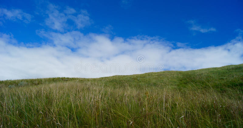 Grassland slopes and the sky royalty free stock images